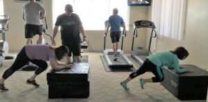 working out at pinnacle fitness - 1400